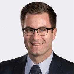Justin Mikhalevsky headshot